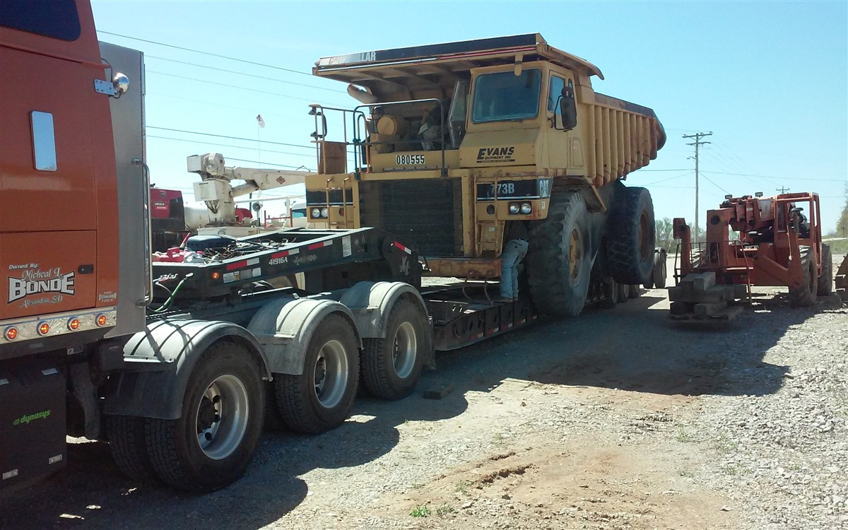Articulated Dump Truck Hauling from Heavy Haulers
