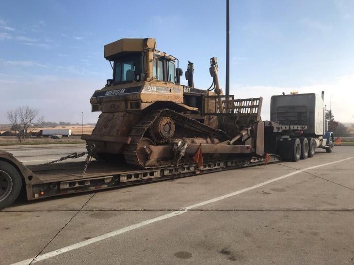 Oversize CAT Bulldozer being hauled