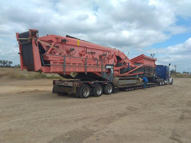Rough Terraine Crane Moved on an RGN Trailer