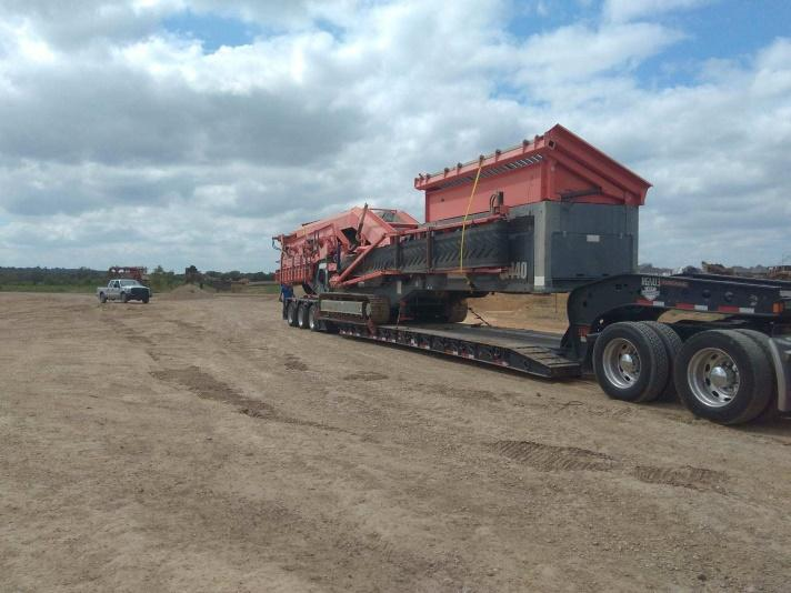 Another angle of rough terrain crane being moved on an RGN