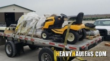 Transporting a riding lawn mower on a flatbed trailer