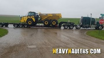 Hyster equipment hauled on an 8 axle RGN trailer