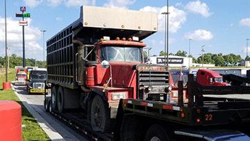 Hauling Mack RD8 Dump Truck