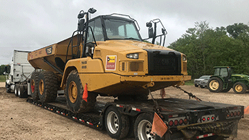 Caterpillar 725C Articulated Truck In Transport