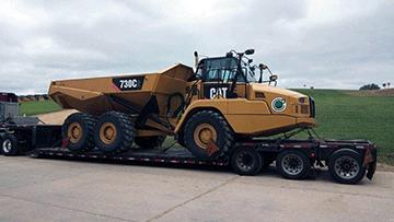 Caterpillar 730C2 Articulated Dump Truck In Transport