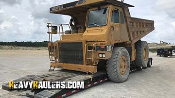 Caterpillar 769C Articulated Dump Truck Tranportation Service