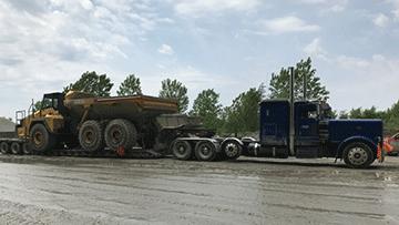 Komatsu HM 400-2 Articulated Dump Truck In Transport