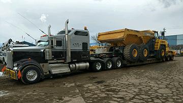Komatsu HM-400 3 Articulated Dump Truck In Transport