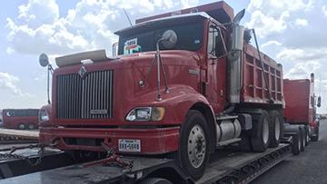 International 4700 Dump Truck In Transport