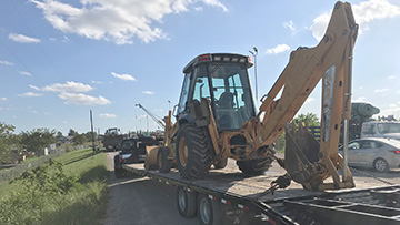Case 580 Backhoe In Transport