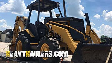 Transporting a Caterpillar 416B Backhoe Loader