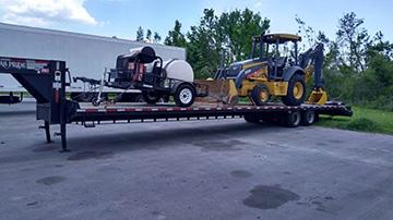 John Deere 310 Backhoe hauled on a hotshot trailer