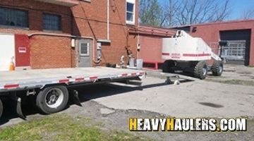 Hauling 1999 Terex TB60 4x4 boom lift with an hotshot trailer