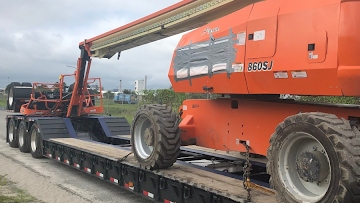 JLG 1850SJ Boom Lift Transported to NY from FL on an RGN Trailer