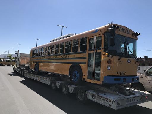 School bus on a flat deck trailer