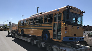 Blue Bird Electric Bus transported on an RGN trailer