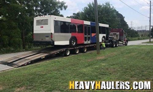 Bus hauled on a step deck trailer