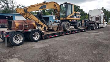 Caterpillar m315 mobile excavator shipped on an rgn trailer