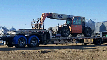 Transporting 2006 JLG G9-43 Boom Lift on a Step Deck