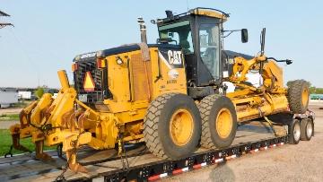 Transporting a Caterpillar motor grader