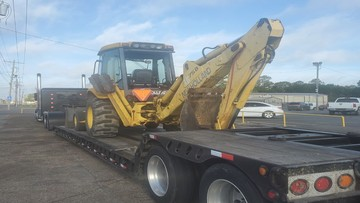 Backhoe being delivered in Louisiana