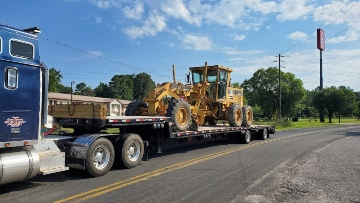 Motor grader transport in Louisiana