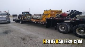 Skid loader transportation in Maine