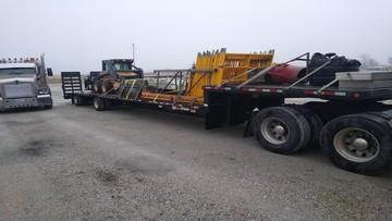 Skid loader transportation in Maine