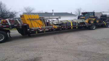 A skid loader being loaded in Massachusetts