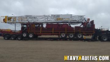Oversize crane transported on a lowboy trailer