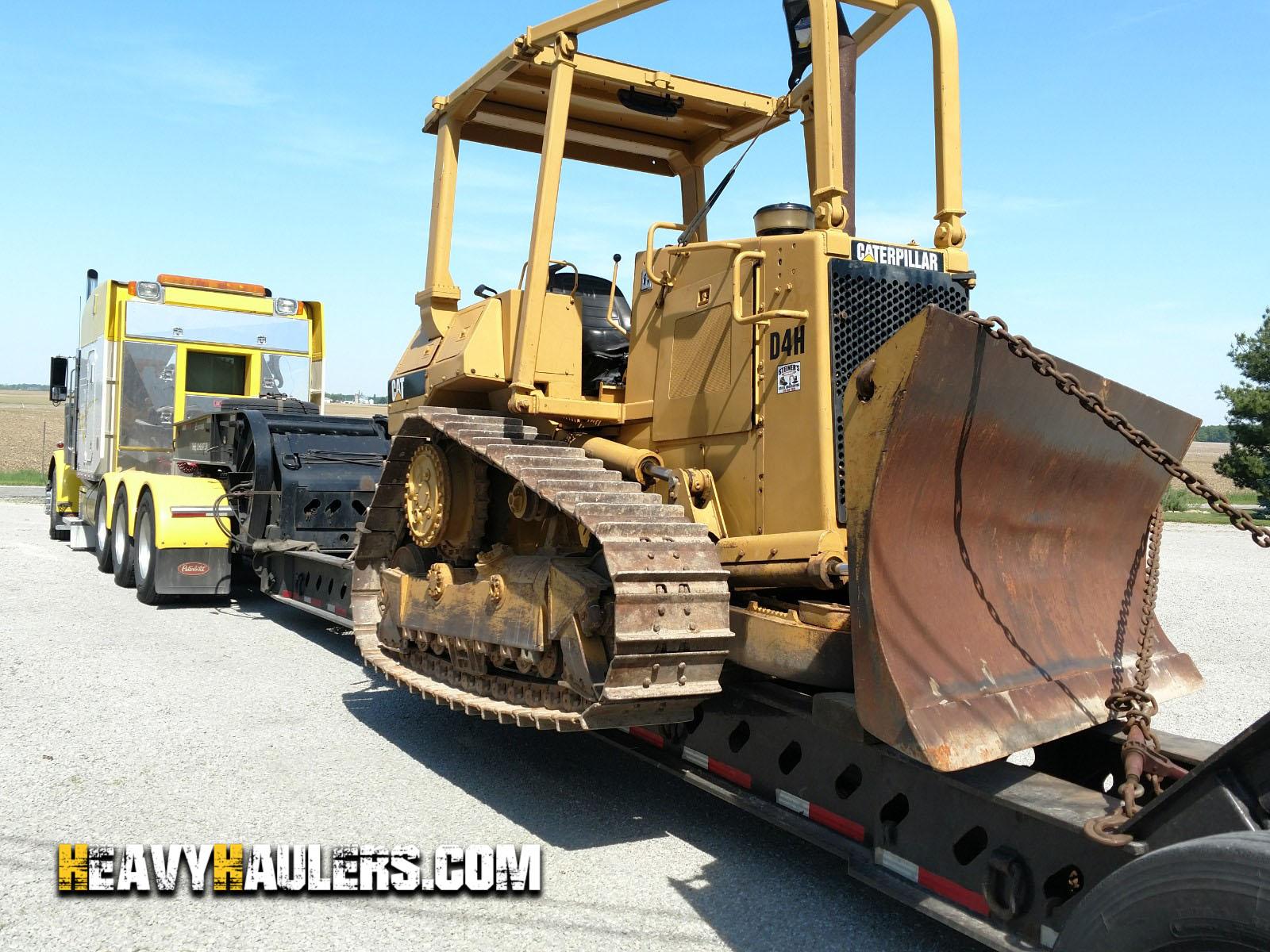 Hauling a Caterpillar D4H bulldozer on a 8 axle trailer
