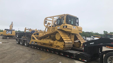 Transporting a Caterpillar D6T dozer on an RGN