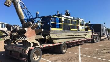 Hauling a dredging machine