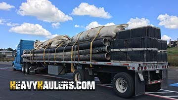 Twelve tons in pipe floats for a dredging machine in transport