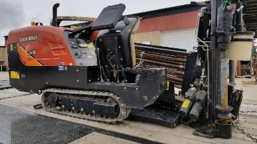 Hauling Ditch Witch JT5 directional drill on a flatbed trailer