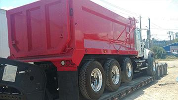 Hauling a 2008 Mack Dump Truck
