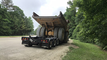 Hauling a Caterpillar 769C Articulated Dump truck