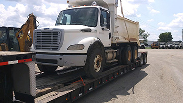 Freightliner Tadem Axle Dump truck In Transport