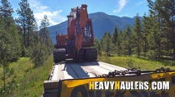 Hitachi UHO 63 Excavator transported on a hotshot trailer