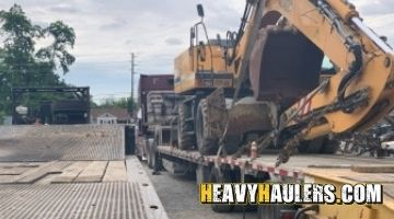 Excavator transport in New York