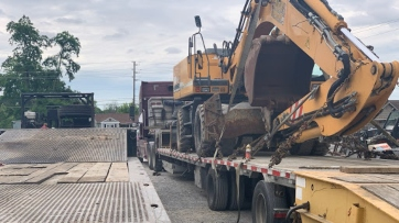 Excavator transport in New York
