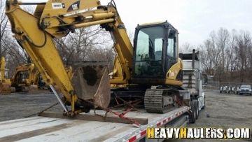 Excavator transport in Massachusetts