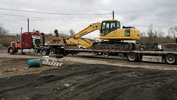 Hauling Komatsu PC 160LC Hydraulic Excavator