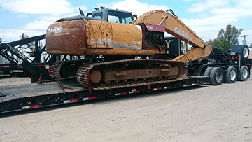 Transporting a Case CX210B Hydraulic Excavator