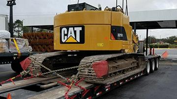 Hauling Caterpillar 321D Hydraulic Excavator