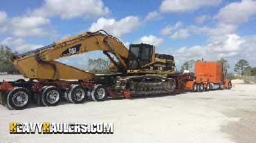 Caterpillar 345BL Hydraulic Excavator in Transport