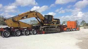Hauling a Caterpillar 345BL Hydraulic Excavator