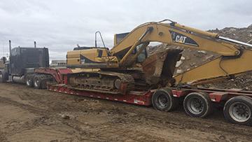 Hauling Caterpillar 316F Hydraulic Excavator