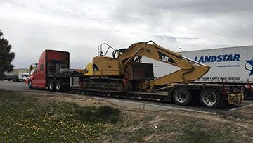 Transporting Caterpillar 321C Hydraulic Excavator