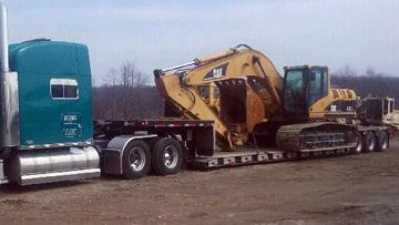 Transporting Caterpillar 325CL Hydraulic Excavator